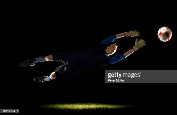 goalkeeper diving for ball - diving to the ground stock pictures, royalty-free photos & images