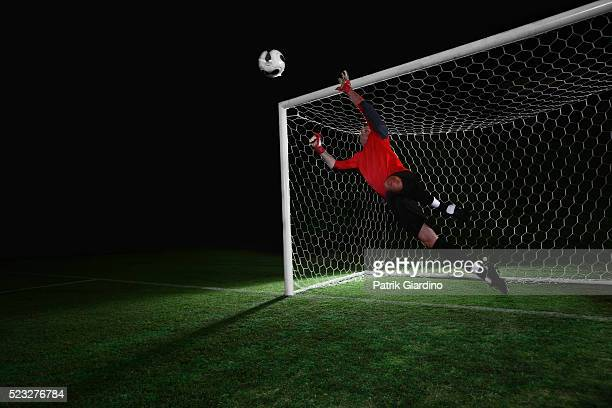goalkeeper diving for ball - goalkeeper stock pictures, royalty-free photos & images