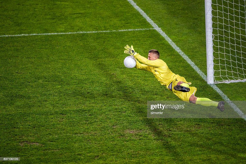 Goalkeeper diving : Stock Photo