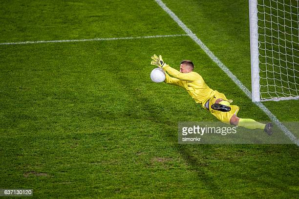 goalkeeper diving - goalie goalkeeper football soccer keeper stock pictures, royalty-free photos & images