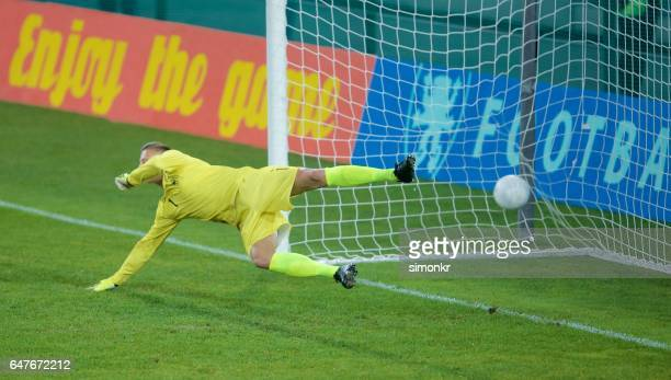 goalkeeper diving - soccer goal stock pictures, royalty-free photos & images