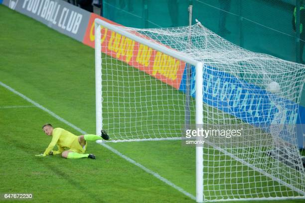 goalkeeper diving - diving to the ground stock pictures, royalty-free photos & images