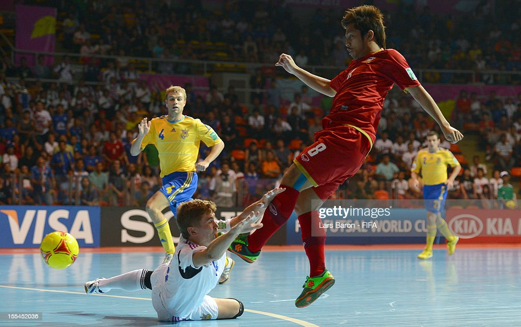 Goalkeeper Dmytro Lytvynenko of Ukraine challenges Jetsada Chudech of Thailand during the FIFA Futsal World Cup Group A match between Thailand and Ukraine at Indoor Stadium Huamark on November 4, 2012 in Bangkok, Thailand.