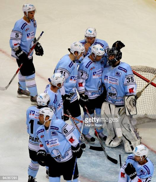 Goalkeeper Domenic Bartels of Hamburg is comforted by his team mates after the DEL match between Hamburg Freezers and Hannover Scorpions at the Color...