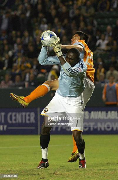 Goalkeeper Donovan Ricketts of the Los Angeles Galaxy catches the ball before Brian Ching of the Houston Dynamo can head in the cross during the MLS...