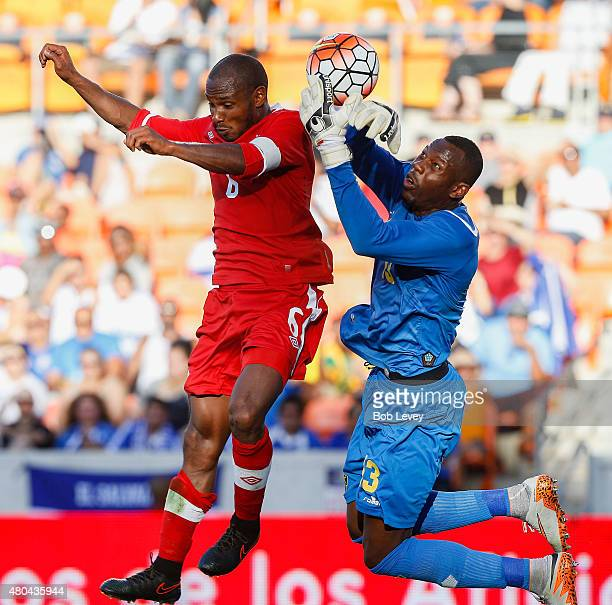 Goalkeeper Dwayne Miller of Jamaica grabs the ball before Julian de Guzman of Canada can get his head on it in the second half at BBVA Compass...