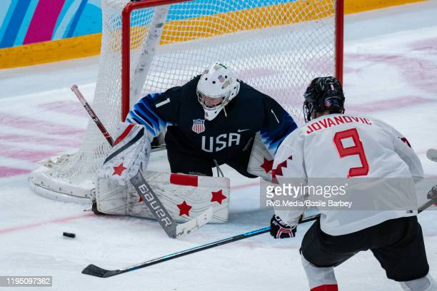 Goalkeeper Dylan Silverstein of United States battles for the puck with Matthew Jovanovic of Canada during Men's 6Team Tournament Semifinals Game...