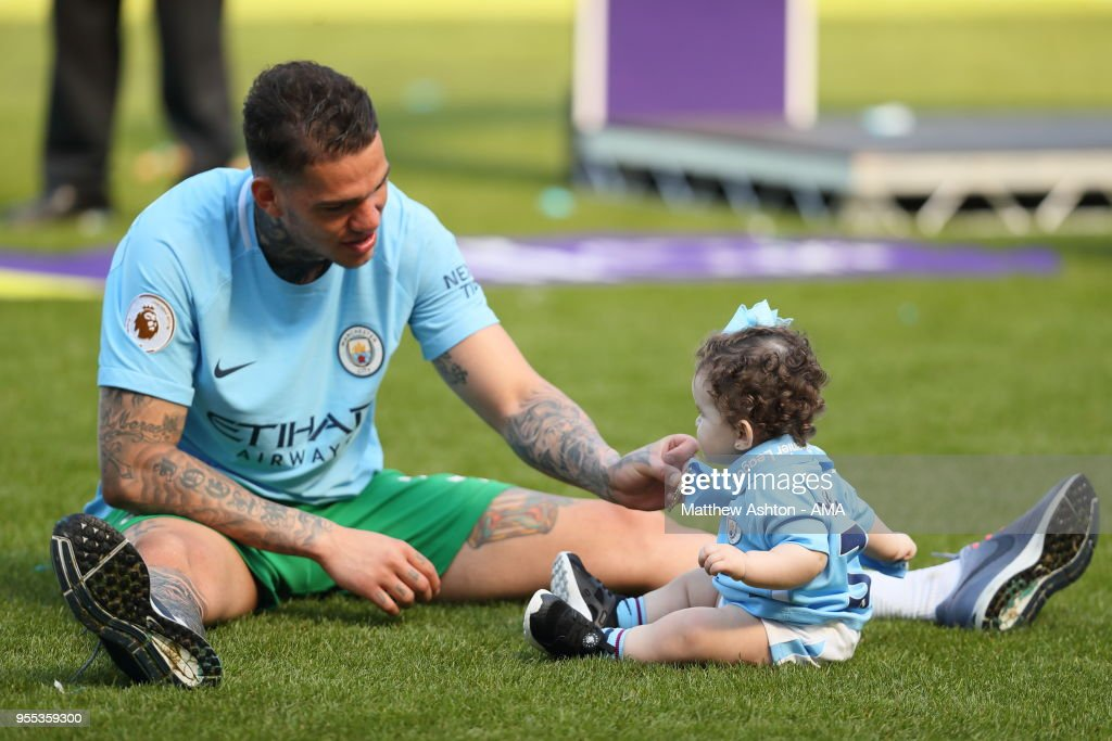 https://media.gettyimages.com/photos/goalkeeper-ederson-moraes-of-manchester-city-puts-his-medal-around-picture-id955359300