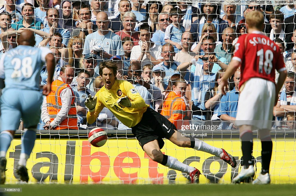 1460b3b17a Goalkeeper Edwin van der Sar (C) of Manchester United saves the penalty  from Darius