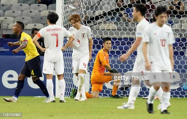 Goalkeeper Eiji Kawashima and other Japanese players react after an Ecuador equalizer during the first half of a 11 draw in Group C of the Copa...