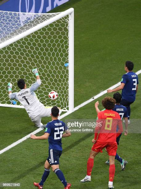 Goalkeeper Eiji Kawashima of Japan is beaten by a header from Jan Vertonghen of Belgium for Belgium's opening goal during the 2018 FIFA World Cup...
