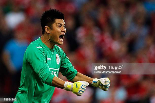 Goalkeeper Eiji Kawashima of Standard Liege screams instructions to team mates during the Second Leg Play Off UEFA Europa League match between Royal...