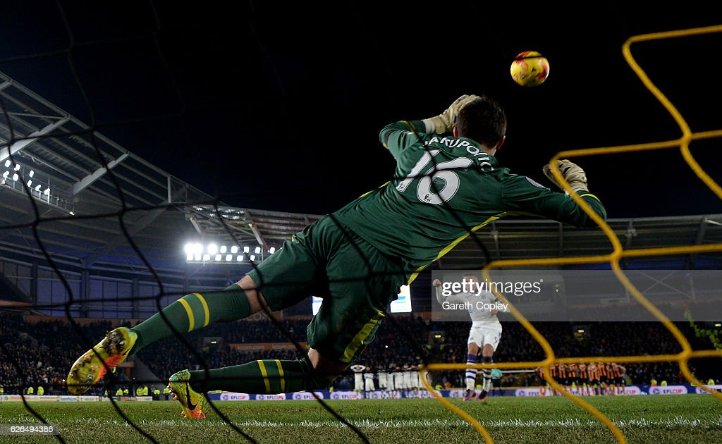 Goalkeeper Eldin Jakupovic of Hull City dives as Dwight Gayle of Newcastle United misses in the penalty shoot out after the EFL Cup Quarter-Final match between Hull City and Newcastle United at KCOM Stadium on November 29, 2016 in Hull, England.