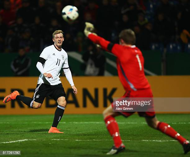 Goalkeeper Elias Rasmussen of Faroe Islands saves a shot from Julian Brandt of Germany during the 2017 UEFA European U21 Championships qualifier...
