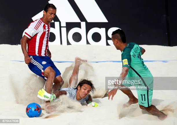 Goalkeeper Elinton Andrade and Be Martins of Portugal battles for the ball with Pedro Moran of Paraguay during the FIFA Beach Soccer World Cup...