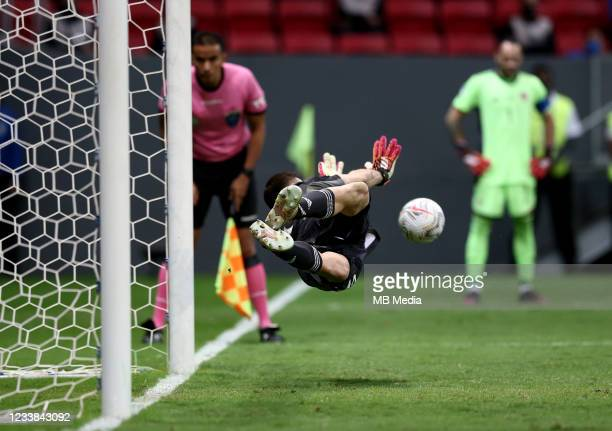 Goalkeeper Emiliano Martinez of Argentina dives to save a penalty kick by Yerry Mina of Colombia in a shootout during the semifinal match against...