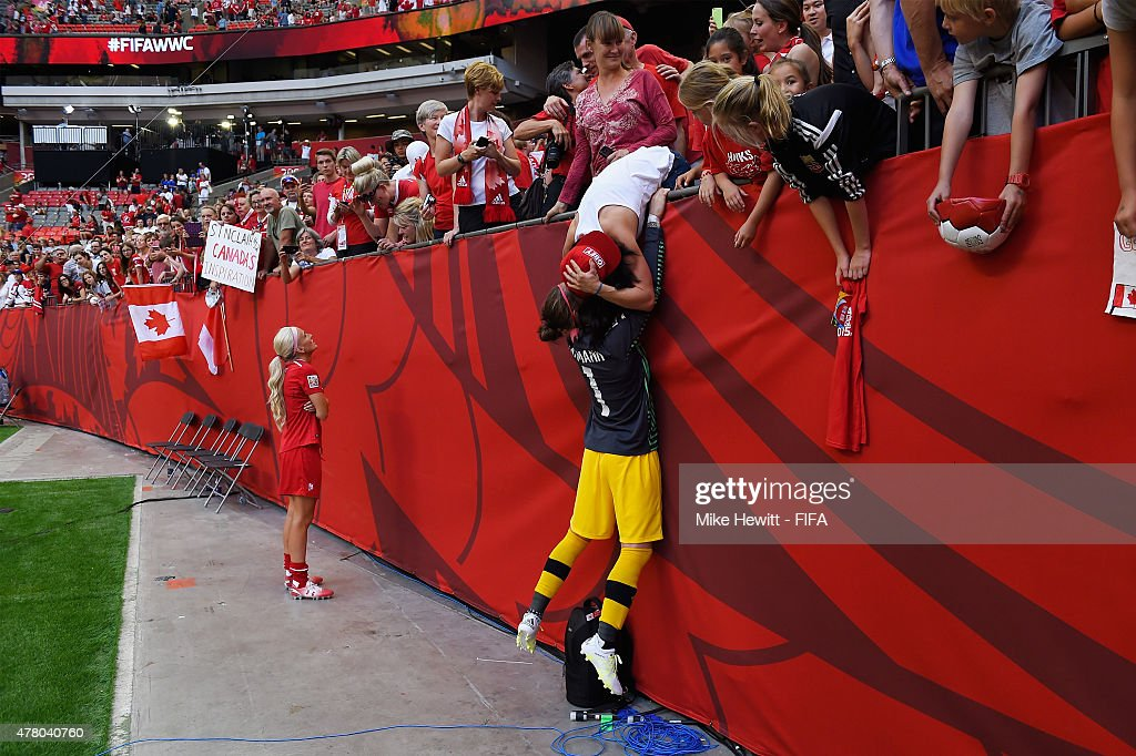 Goalkeeper Erin McLeod celebrates with girlfriend Ella Masar at the end of the FIFA Women's World Cup 2015 Round of 16 match between Canada and Switzerland at BC Place Stadium on June 21, 2015 in Vancouver, Canada.