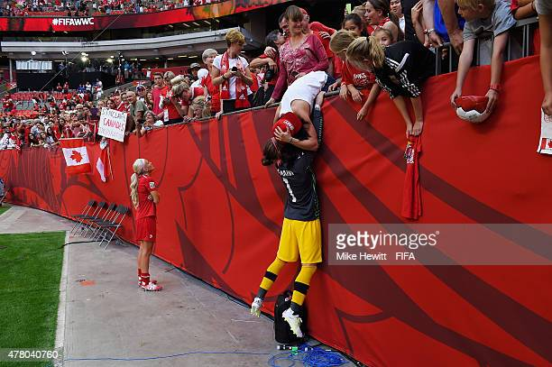 Goalkeeper Erin McLeod celebrates with girlfriend Ella Masar at the end of the FIFA Women's World Cup 2015 Round of 16 match between Canada and...