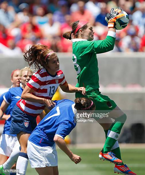 Goalkeeper Erin McLeod of Canada takes the ball away from Alex Morgan of the USA and Rhian Wilkinson during the first half of the women's Olympic...