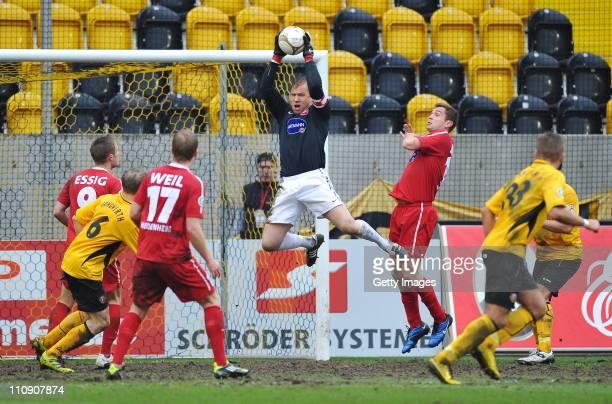 Goalkeeper Erol Sabanov of Heidenheim saves the ball during the Third League match between Dynamo Dresden and 1. FC Heidenheim at the Rudolf Harbig...