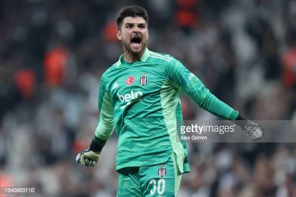 Goalkeeper Ersin Destanoglu of Besiktas celebrates their side's first goal during the UEFA Champions League group C match between Besiktas and...