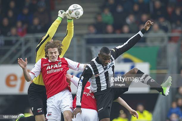 goalkeeper Esteban Alvarado Brown of AZ Etienne Reijnen of AZ Geoffrey Castillion of Heracles Almelo during the Dutch Eredivisie match between...