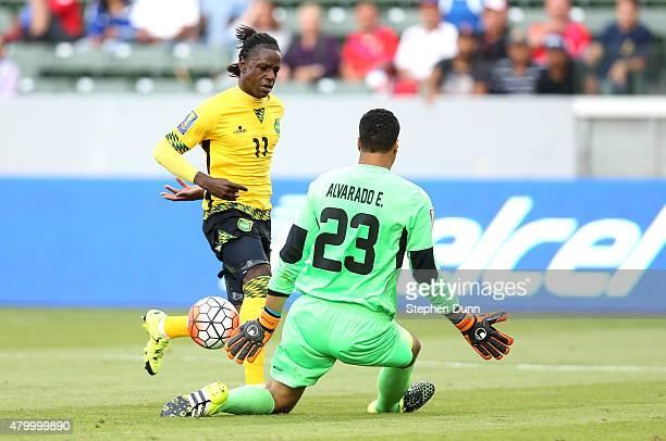 Goalkeeper Esteban Alvarado of Costa Rica stops an attack byDarren Mattocks of Jamaica in their CONCACAF Gold Cup Group B match at StubHub Center on...