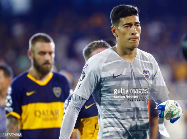 Goalkeeper Esteban Andrada and Daniele De Rossi of Boca Juniors leave the field after losing a match between Rosario Central and Boca Juniors as part...