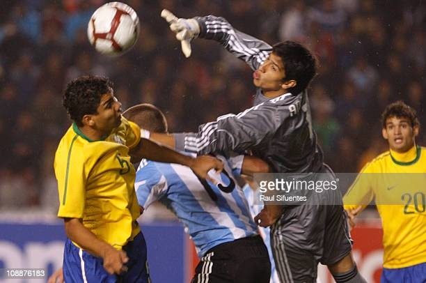 Goalkeeper Esteban Andrada of Argentina struggles for the ball with Casemiro of Brazil duringr a match as part of the South American U20 Championship...