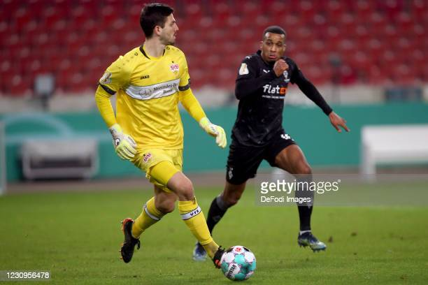Goalkeeper Fabian Bredlow of VfB Stuttgart and Alassane Plea of Borussia Moenchengladbach battle for the ball during the DFB Cup Round of Sixteen...