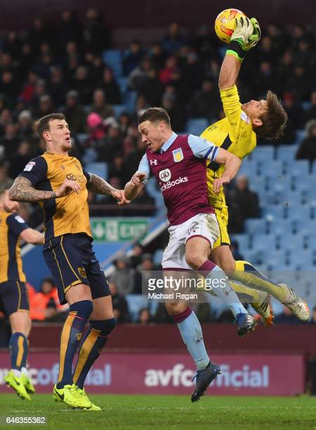 Goalkeeper Fabian Giefer and Aden Flint of Bristol City defend against James Chester of Aston Villa during the Sky Bet Championship match between...