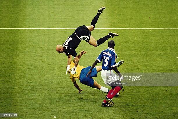 Goalkeeper Fabien Barthez of France clashes with Ronaldo of Brazil as Lilian Thuram looks on during the 1998 FIFA World Cup final on 12 July 1998...