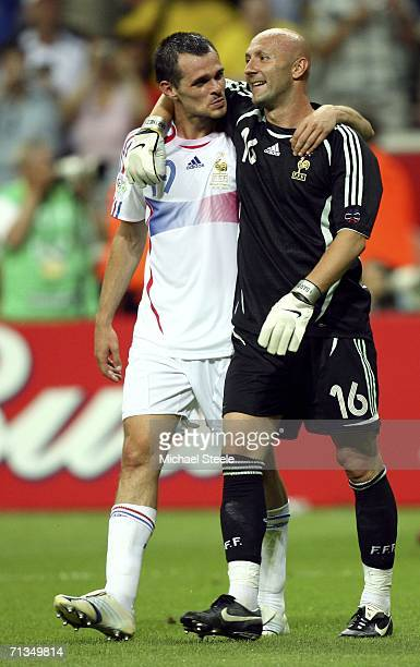 Goalkeeper Fabien Barthez of France is hugged by teammate Willy Sagnol following their team's 10 victory during the FIFA World Cup Germany 2006...