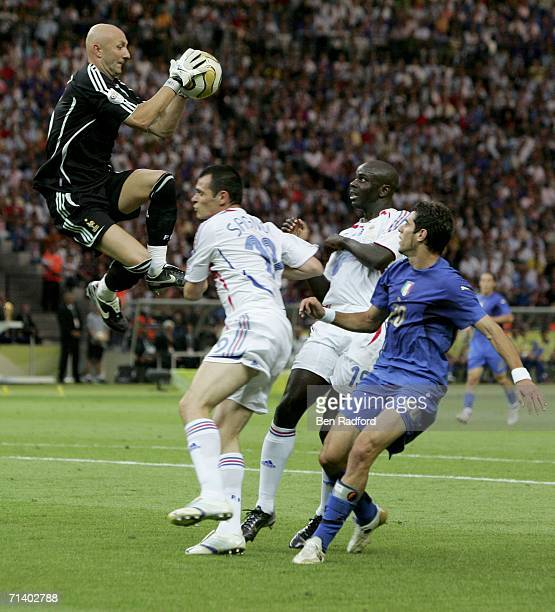 Goalkeeper Fabien Barthez of Francejumps to claim the ball during the FIFA World Cup Germany 2006 Final match between Italy and France at the Olympic...