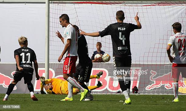 Goalkeeper Fabio Coltorti of Leipzig without a chance Lennart Thy of St Pauli scores the opening goal during the Second League match between RB...