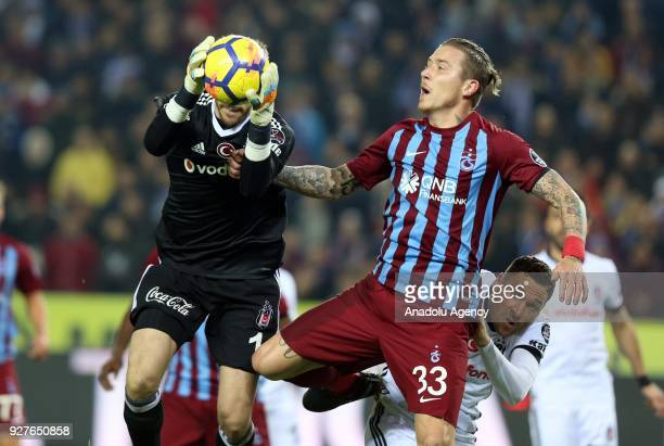 Goalkeeper Fabri of Besiktas in action against Kucka of Trabzonspor during the Turkish Super Lig soccer match between Trabzonspor and Besiktas at...