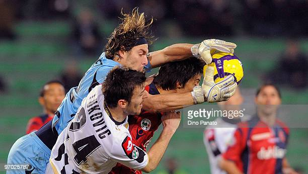 Goalkeeper Federico Marchetti of Cagliari catches the ball in the air ahead of Aleksandar Lukovic of Udinese during the Serie A match between Udinese...