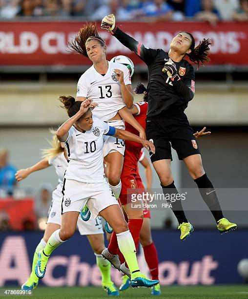 Goalkeeper Fei Wang of China is challenged by Carli Lloyd of USA and Alex Morgan of USA during the FIFA Women's World Cup 2015 Quarter Final match...