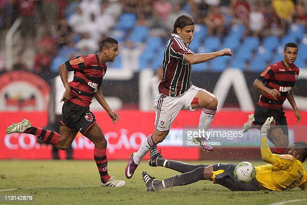 Goalkeeper Felipe of Flamengo struggles for the ball with Rafael Moura of Fluminense during a match as part Semifinal of Rio de Janeiro State...