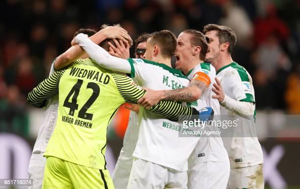 Goalkeeper Felix Wiedwald and team mates celebrate the 11 draw of Bremen during the Bundesliga soccer match between Bayer Leverkusen and Werder...