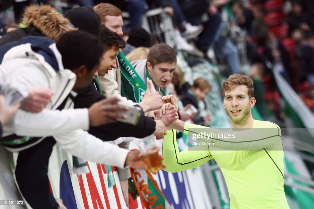 Goalkeeper Felix Wiedwald of Bremen celebrates with the fans after the Bundesliga match between 1. FSV Mainz 05 and Werder Bremen at Opel Arena on February 18, 2017 in Mainz, Germany.