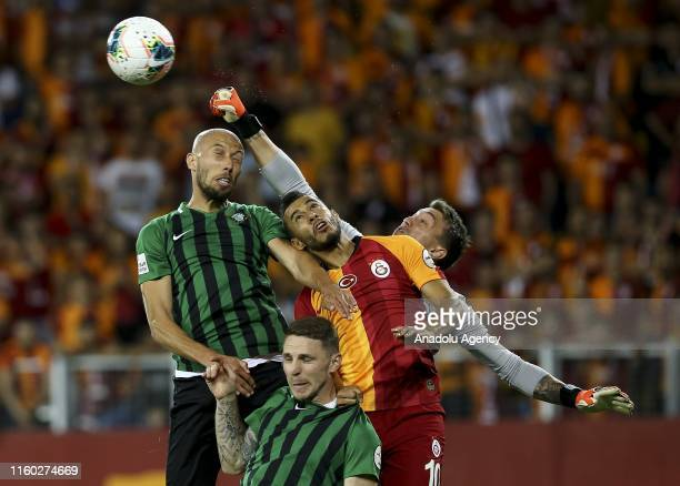 Goalkeeper Fernando Muslera and Younes Belhanda of Galatasaray in action during 2019 Turkish Super Cup match between Galatasaray and Akhisarspor at...