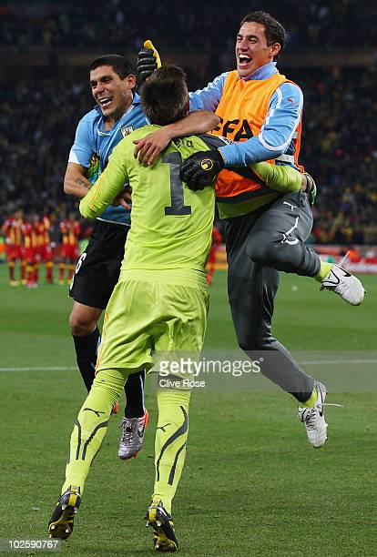 Goalkeeper Fernando Muslera of Uruguay celebrates victory after winning a penalty shoot out during the 2010 FIFA World Cup South Africa Quarter Final...