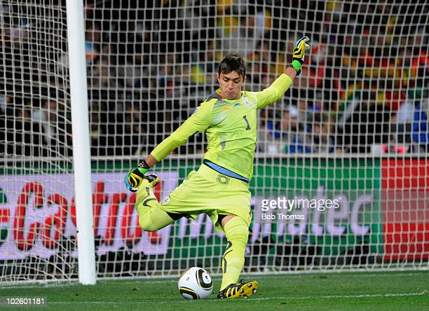 Goalkeeper Fernando Muslera of Uruguay kicks the ball during the 2010 FIFA World Cup South Africa Quarter Final match between Uruguay and Ghana at...