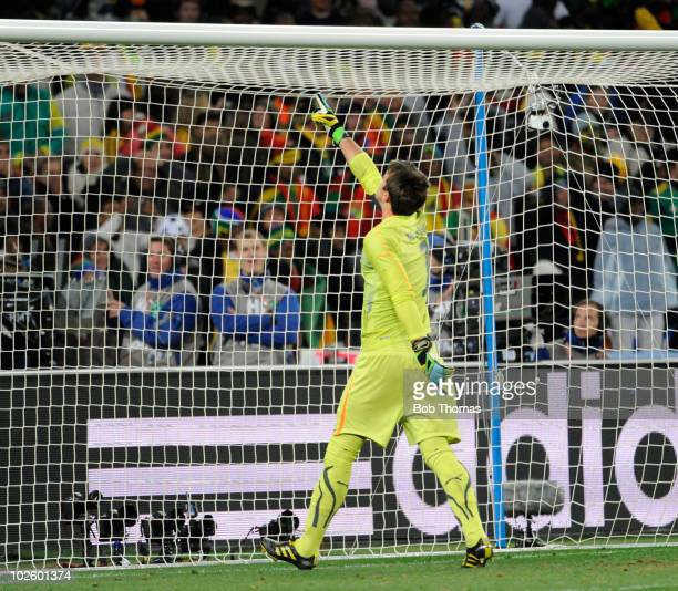 Goalkeeper Fernando Muslera of Uruguay points to the goal cross bar after Asamoah Gyan of Ghana missed his penalty during the 2010 FIFA World Cup...