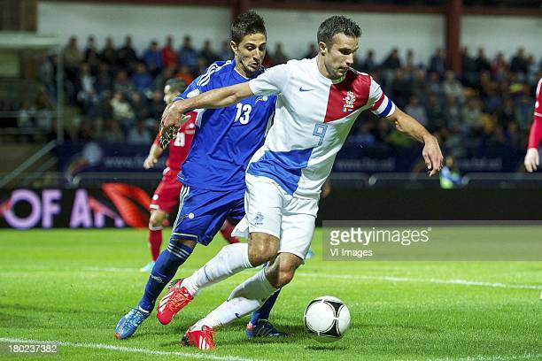 goalkeeper Ferran Pol Perez of Andorra Robin van Persie of Holland during the FIFA 2014 World Cup qualifier match between Andorra and the Netherlands...