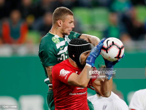 Goalkeeper Filip Pajovic of Ujpest FC catches the ball before Roland Varga of Ferencvarosi TC during the Hungarian OTP Bank Liga match between...
