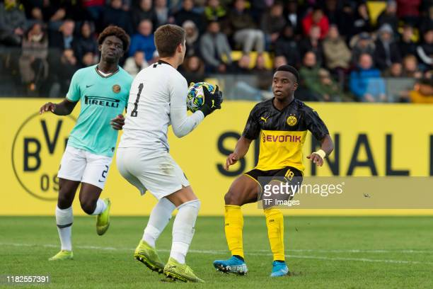 Goalkeeper Filip Stankovic of Inter Mailand U19 and Youssoufa Moukoko of Borussia Dortmund U19 battle for the ball during the UEFA Youth League match...