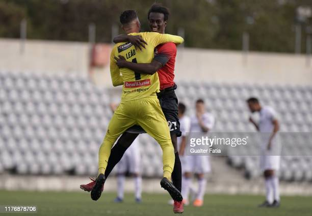 Goalkeeper Filipe Leao of Club Sintra Football celebrates the victory with teammate Braudilio of Club Sintra Football after the penalty shootout at...