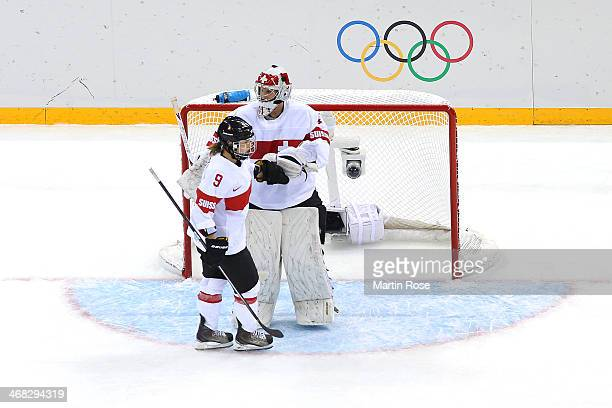 Goalkeeper Florence Schelling of Switzerland looks dejected next to Stefanie Marty of Switzerland during the Women's Ice Hockey Preliminary Round...
